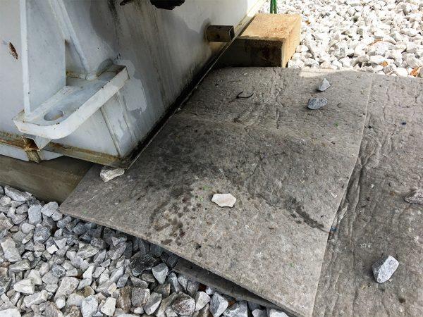 Husky PolyBack Rugs hold onto transformer oil and prevent rain from spreading onto surrounding gravel copy