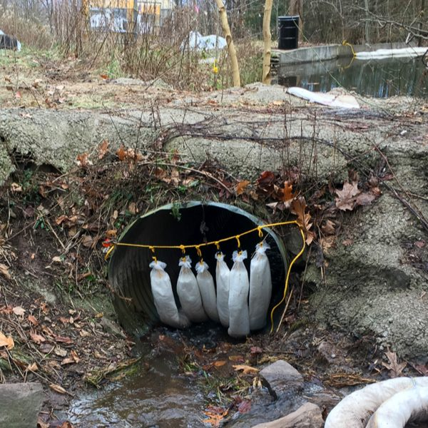 SkimBoa in Culvert cleaning up oil fuel spill on water